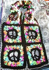 Ravelry: Stained Glass Peace Sign Scarf or Afgan Square pattern by Spider Mambo.. Free pattern!