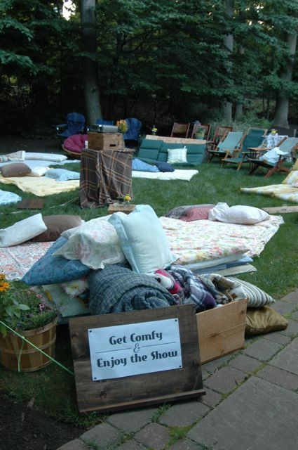 Host a movie night on your lawn and provide your guests with comfy blankets and pillows to relax and lounge on.