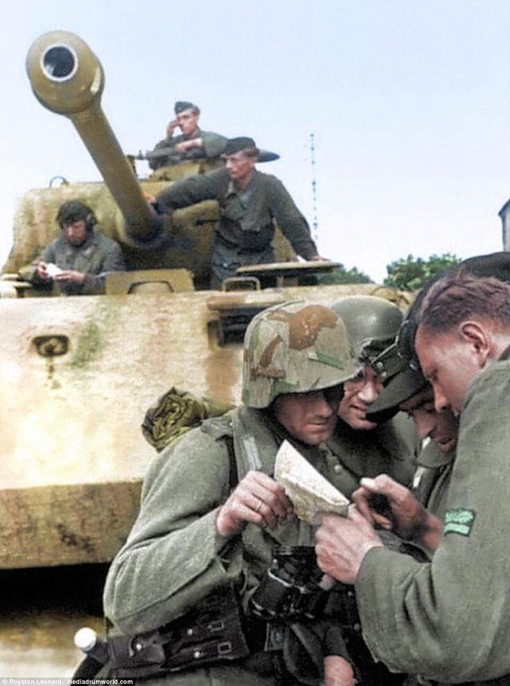 Four Nazi soldiers of the Panzer Lehr division gather around a map as they plan their offensive in the town of Tilly-sur-Seulles.The Panzer Lehr division was an elite German armoured division during World War Two. It was formed in 1943 onwards from training and demonstration troops  stationed in Germany, to provide additional armoured strength for the anticipated Allied invasion of western Europe. It was the only Wehrmacht Panzer division to be fully equipped with tanks and with half-tracks…