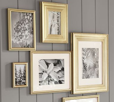 If you do want to go with a gold starburst mirror, here's a way to incorporate more gold into the space.  Put these with b images above nighstands.  PB Gilt Frames #potterybarn