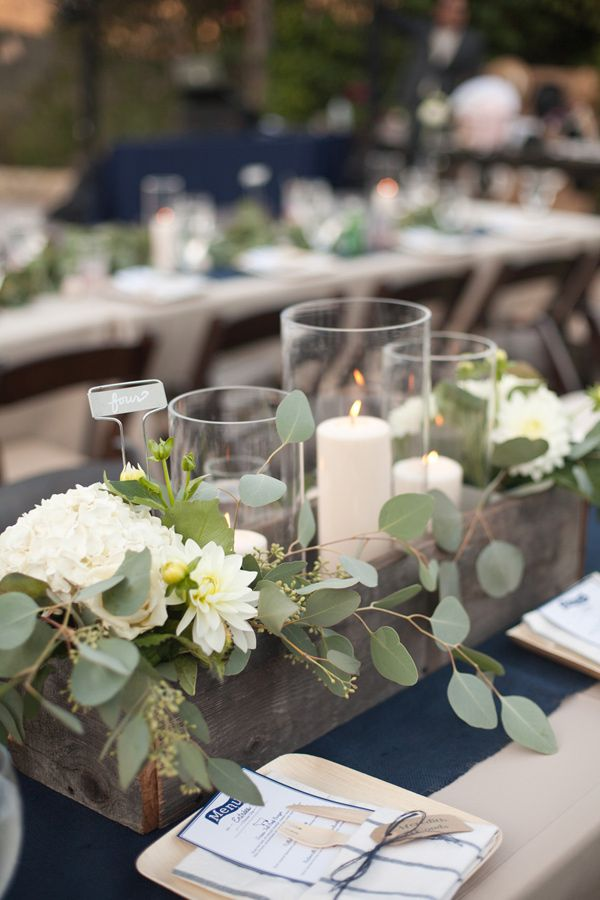 eucalyptus and candle centerpiece, photo by Katrina Louise http://ruffledblog.com/secluded-garden-estate-wedding #centerpieces #wedding #reception