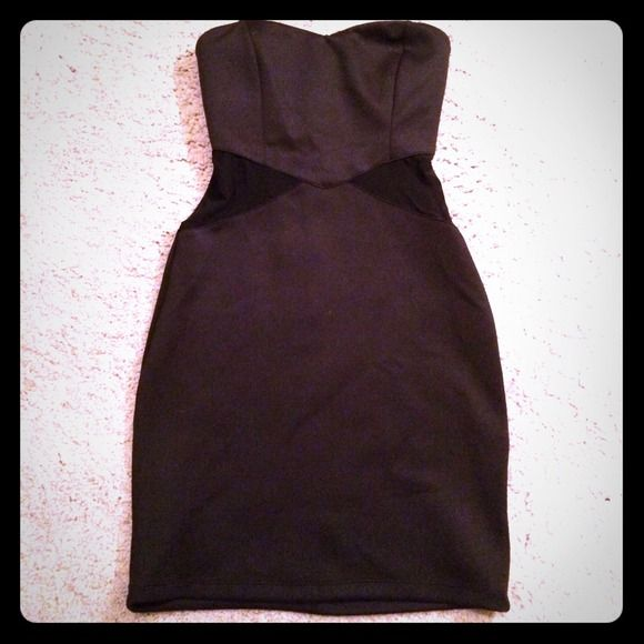 Cute tight black tube dress Cute black tube dress, with sheer cut outs on left and right, zipper closure in the back, never worn. Forever 21 Dresses Strapless