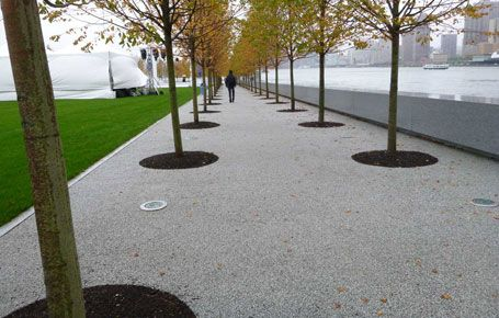 A grey coloured resin bound gravel.  It also highlights how harsh I think the light grey limestone paving would look.