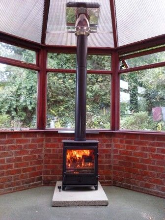 wood burner in a conservatory
