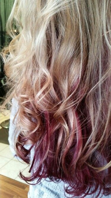 Blonde foils with dark red violet shadow underneath. Long layers. Curled. Highlights lowlights