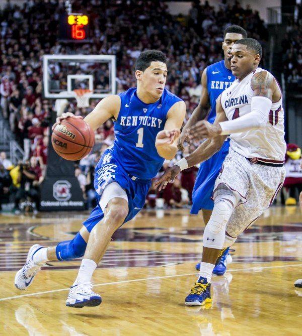 Kentucky Wildcats guard Devin Booker (1) drives around South Carolina guard Tyrone Johnson (4)
