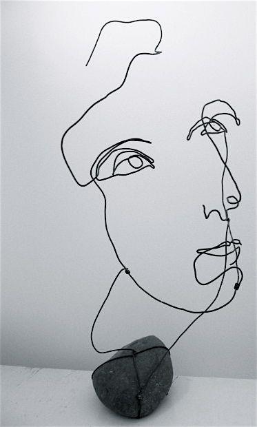 Wire portrait with rock                                                                                                                                                                                 Más