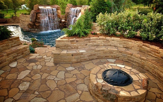 Flagstone Patio And Stone Bench Retaining Walls With Fire