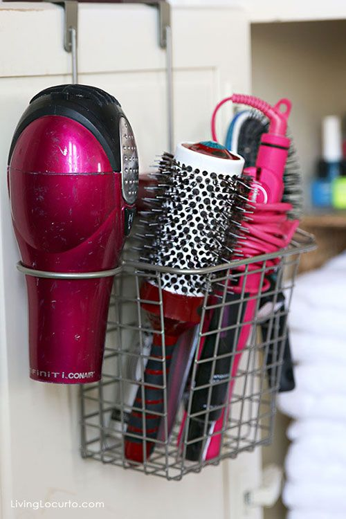 Genius idea for easy bathroom organization! Hang this metal basket over a cabinet to hold hair dyer, curling irons and brushes.