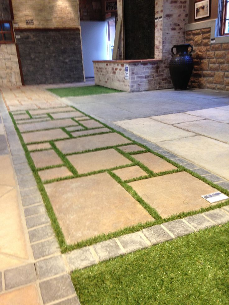 Revelstone paver with astra turf infill idea for central courtyard surround