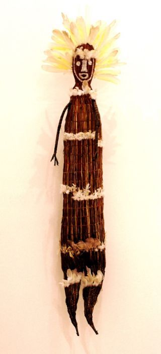Lena Yarinkura [Kune/Rembarrnga people,  Australia]  Yawkyawk (female water spirit) (2004) Twined pandanus palm leaf, paperbark, natural pigments, feathers and PVC fixative 195.5 x 47 x 26cm. Purchased 2004.
