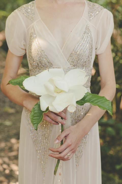One simple magnolia / via Laura & Reece's Classic New Zealand Wedding on The LANE / Lene Photography