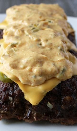 Cheeseburger Meatloaf with Famous Burger Sauce Recipe ~ The result is a whole lot of deliciousness. This meatloaf recipe includes all the cheeseburger favorites: juicy beef, soft bread cubes, flavorful onions, tangy pickles, melty cheese. And that sauce.