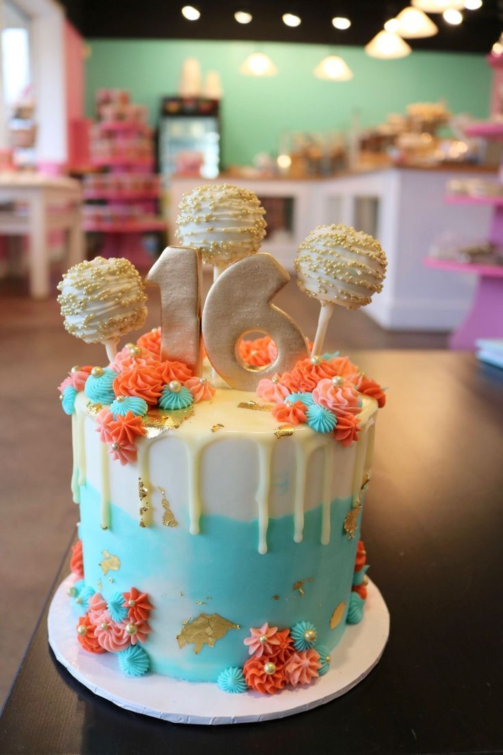 Blue And Coral Cake With Rosettes And Gold Foil The Cake Has Cake Pops On Top A Sweet Sixteen Cakes Sweet 16 Birthday Cake 16th Birthday Cake For Girls