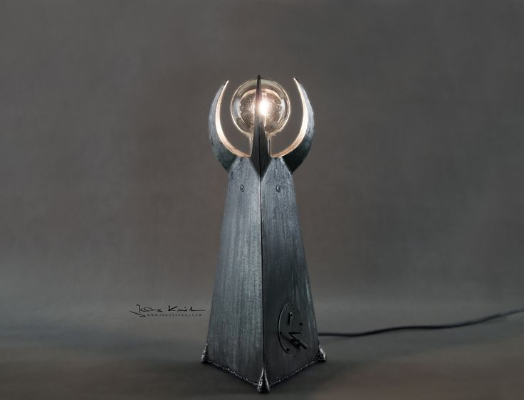Table lamp designed by Janusz Król. Stainless steel.
