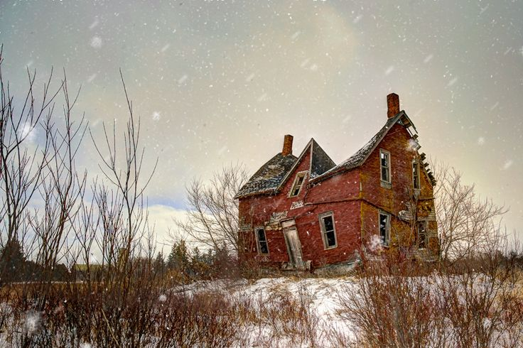 This old farmhouse still defiantly stands against a winter storm in Ontario, Canada.