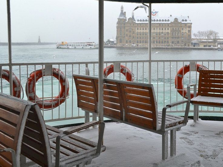 Locals ride the ferries year round, even on snowy days. Leaving the Kadikoy pier of the Asian side, you'll see this view of historical Haydarpasa train station.