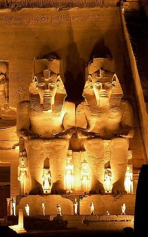 The Abu Simbel temples are two massive rock temples in Abu Simbel, a small village in Nubia, southern Egypt, near the border with Sudan. They are situated on the western bank of Lake Nasser, about 230 km southwest of Aswan.
