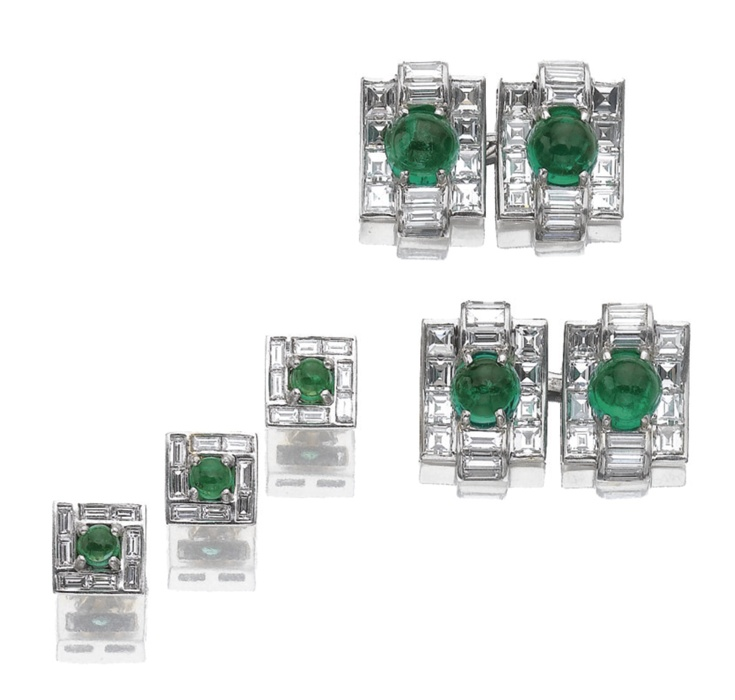 Pair of emerald and diamond cufflinks, Cartier, 1955 and three shirt studs. The pair of cufflinks centring on a cabochon emerald to a rectangular curved ground of square-cut and baguette diamonds, signed Cartier and numbered, together with three shirt studs of similar inspiration.