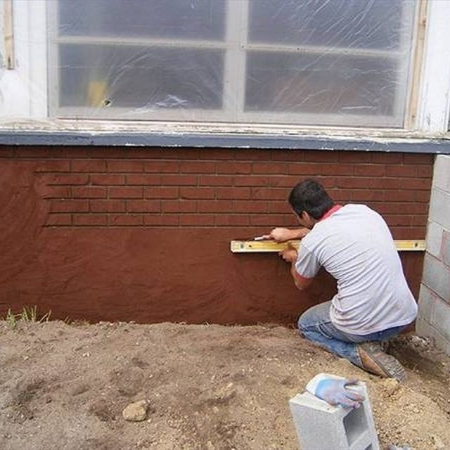 A yardstick and a level will help create a faux brick pattern on stucco.