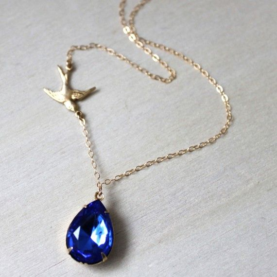 $30  Sapphire Blue Glass Teardrop Gem and Sparrow Bird Gold Necklace.  www.threebirdsdesigns.etsy.com