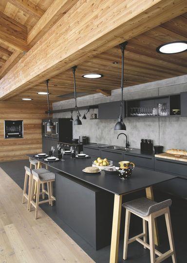 Black design kitchen + concrete backsplash