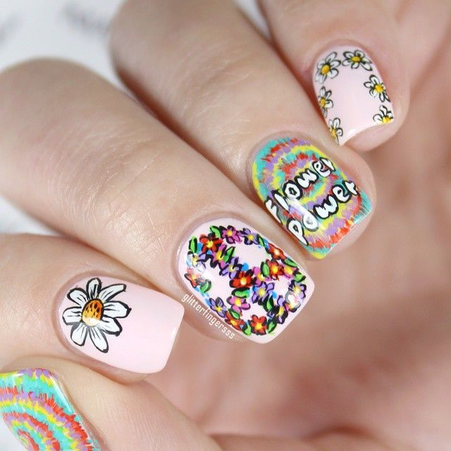 """I made this mani for a Rimmel contest. The task was to create a hippie nail art, so I did this. I went with the traditional hippie symbols: tie-dye, peace sign and Flower Power! All of it was handpainted with acrylic paint. #craftyfingers #hippie #nails2inspire #sgnailartpromote #nailpromote #polishlicious #polishnsuch #nailitdaily #nailsoftheday #nailsofinstagram"" Photo taken by @glitterfingersss on Instagram, pinned via the InstaPin iOS App! http://www.instapinapp.com (07/01/2015)"