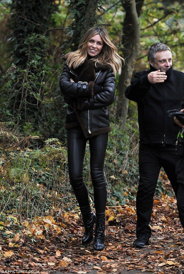Wintry look: The Strictly Come Dancing winner stuck to a moody autumnal palette with her outfit that matched the surrounding woodland
