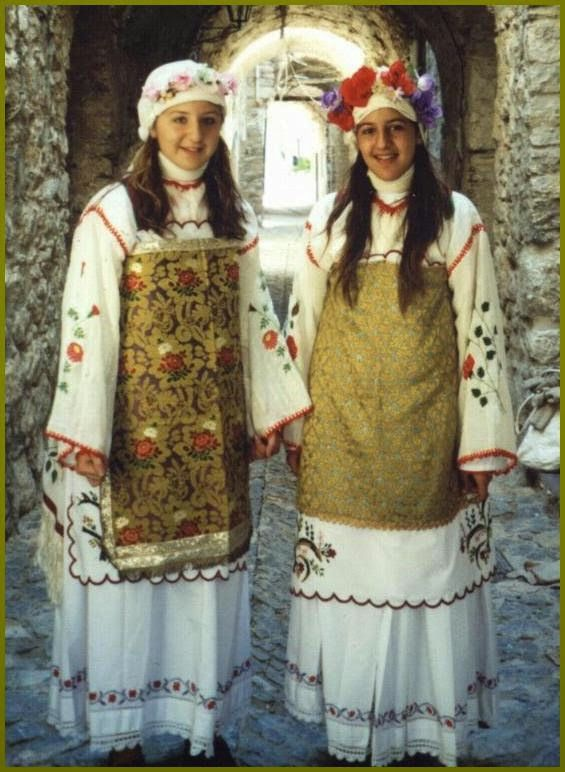 "Traditional costumes from Mesta, Chios island, Greece/Παραδοσιακες φορεσιες απο τα Μεστα της Χιου. ""Η Μπαμπαζίνα ήταν η νυφική φορεσιά των Μεστών. Αποτελούταν από μια ρουγιαστή φούστα,  στενομάνικο (πουκάμισο),  φαρδομάνικο, το Σαμαράκι, το Τσερδέ, την ποδιά, την μπαμπαζίνα (μαντίλα) απ' όπου πήρε και το όνομα της και το στεφάνι."""