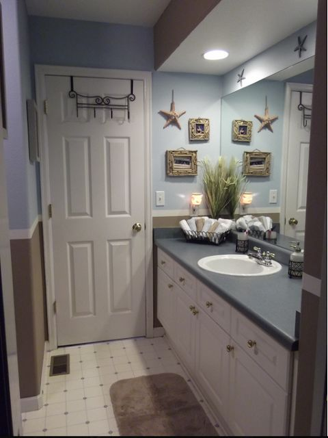 natural and nautical accessories like seashells, starfish, and vintage beach signs are the perfect finishing touches for beach-inspired bathrooms