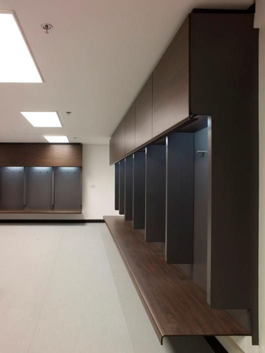 Wembley Stadium locker room. Again, the trend seems to be to modernize stadium locker rooms with wood, dark colors, and clean design. This locker room is stunning. #changing room