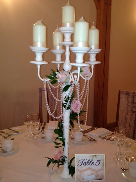 Ivory candelabra with blush flowers and pearls to decorate guest tables at Rivervale Barn by www.tarniawilliams.co.uk
