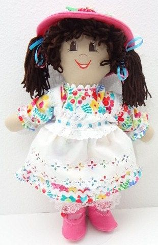 """I am a wonderful cloth handmade rag doll. I have brown pigtails, brown eyes, and warm honey tan skin. They tell me Im ethnic...whatever that means...I guess it means Im cute...  This is a My New Friend rag doll that is hale and hearty and expects to go where your child goes and do what your child does. If you hug the doll she will hug you back, cloth dolls do that. She is about 18""""-20"""" tall and other than scissors, she has no natural enemies. She will play all day and then keep the """"goes…"""