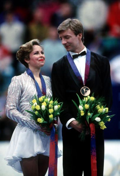 Team GB's Jayne Torvill and Christopher Dean receive their bronze medals at the 1994 Lillehammer Winter Olympic Games.