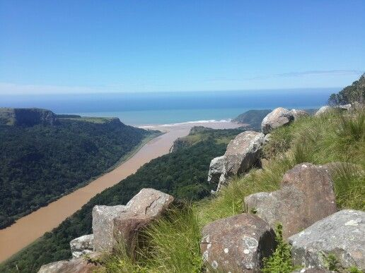 Umzimvubu river meeting the ocean at Port st. Johns, South Africa