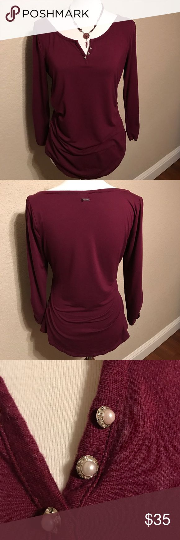 WHBM Cranberry Sophisticated Tee White House Black Market cranberry casual tee, with more sophisticated details. 3/4 sleeve. Pearl and rhinestone false buttons. Super soft fabric. Fits true to size. White House Black Market Tops