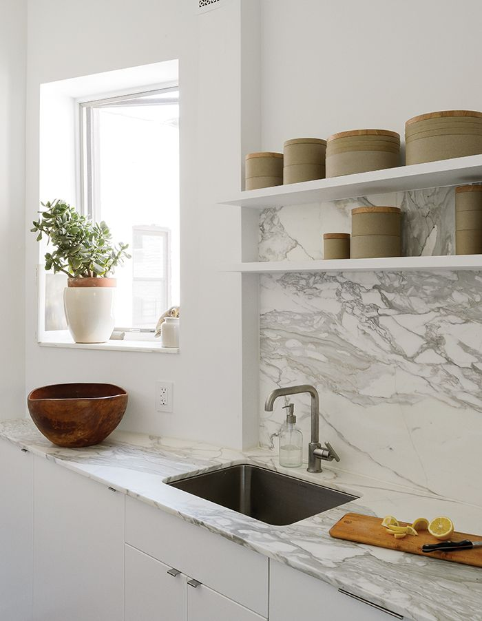 Modern Brooklyn apartment kitchen with Borghini marble countertop and backsplash (Jacqueline Schmidt)