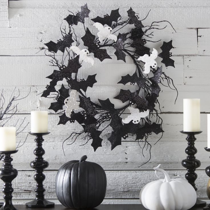 22 in. Halloween Glitter Bats and Ghosts Wreath - For a nice welcome to Halloween, the 22-inch Halloween Glitter Bats and Ghosts Wreath fits the chill. Constructed of plastic and covered with glitter,...