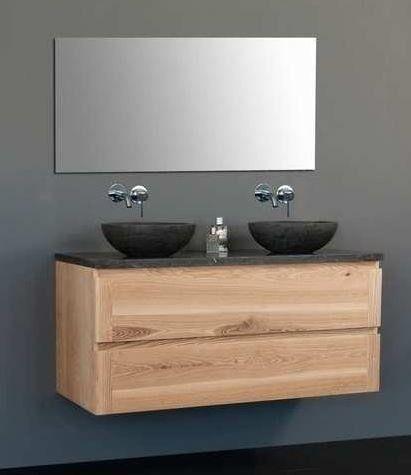 Dit badmeubel bestaat uit een wasblad, twee waskommen, een onderkast die gebruikt maakt van een soft closing lade systeem en een spiegel. De gehele onderkast is van watervast MDF.