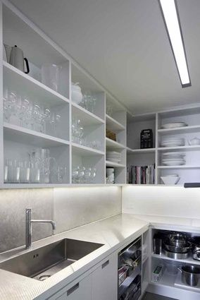 Scullery kitchen with lots of bench space and storage in open shelving also has a sink - perfect!
