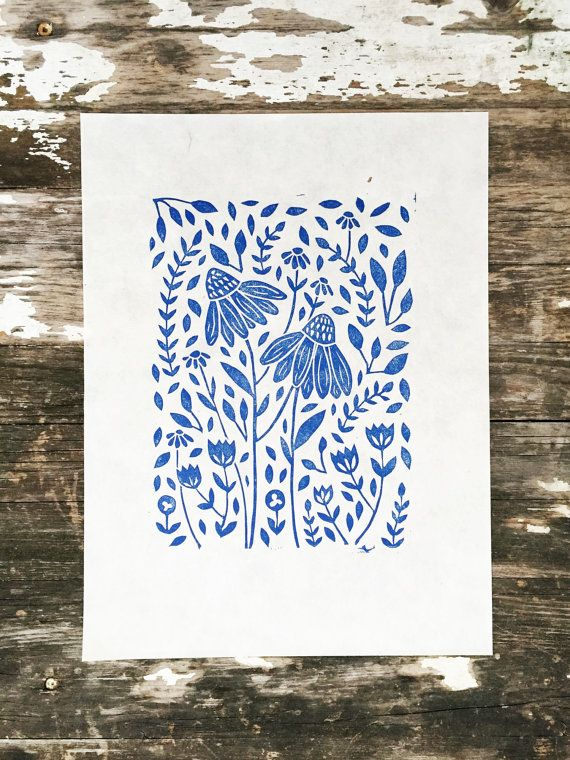 This is an original linocut print titled Flora. Hand crafted from start to finish with sustainable materials. Printed in blue eco-friendly ink.