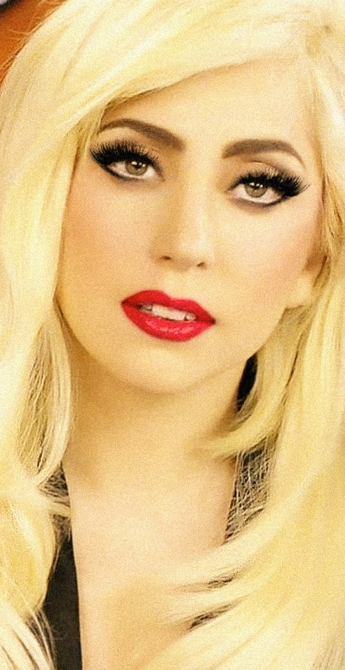 Love Lady Gaga's look here. Dramatic black liner, lashes enhanced with some white highlighting the bottom waterline and a bold, crisp red lip!