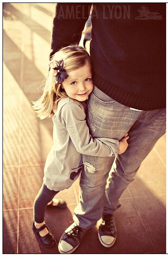 cute pose for Daddy's girl.  i have to get this lola hugs ryan like this everyday when he leaves!!