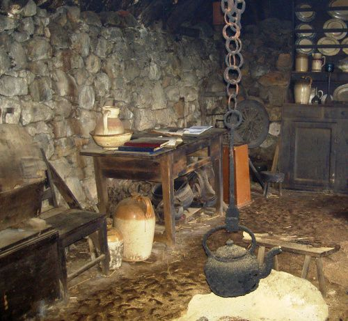Inside of a typical 19th century croft blackhouse in the Highlands of Scotland which would have been similar to the dwellings occupied by the inhabitants of St. Kilda. Above croft blackhouse can be seen at Colbost Folk Museum, Colbost, Isle of Skye.