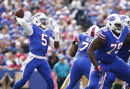 49ers vs. Bills:     October 16, 2016  -  45-16, Bills  -    Oct 16, 2016; Orchard Park, NY, USA; Buffalo Bills quarterback Tyrod Taylor (5) throws a pass under pressure by the San Francisco 49ers during the first half at New Era Field. Mandatory Credit: Kevin Hoffman-USA TODAY Sports