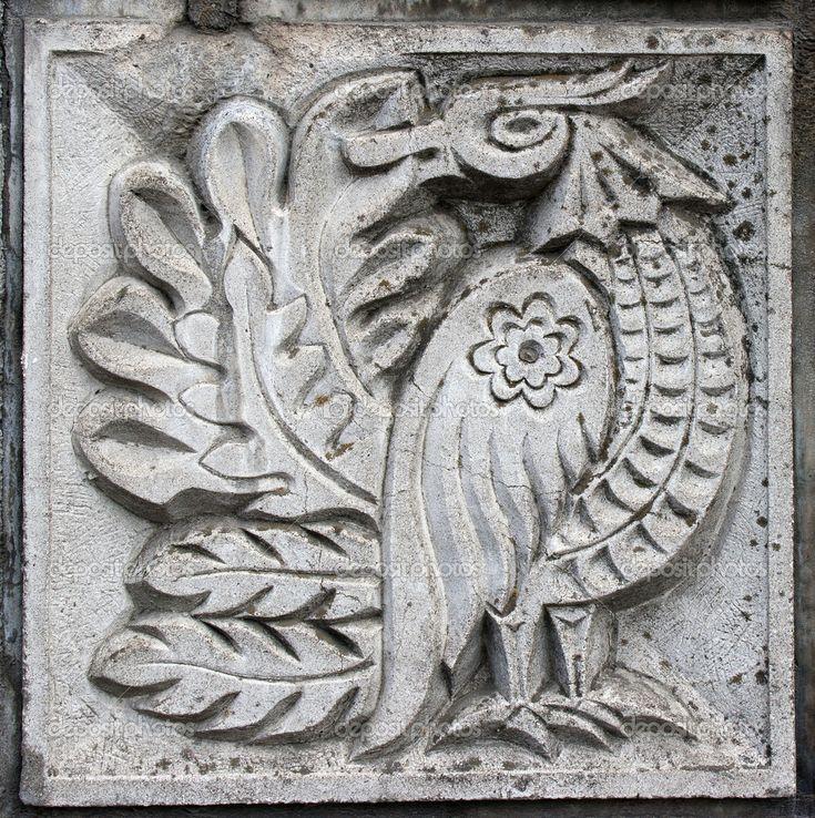 Bas-relief of fairytale bird - Stock Image: 5763590