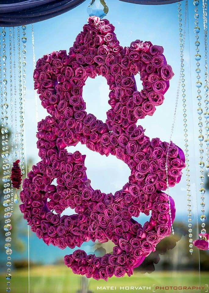 Close-up of floral Ganesh for backdrop -- wedding color