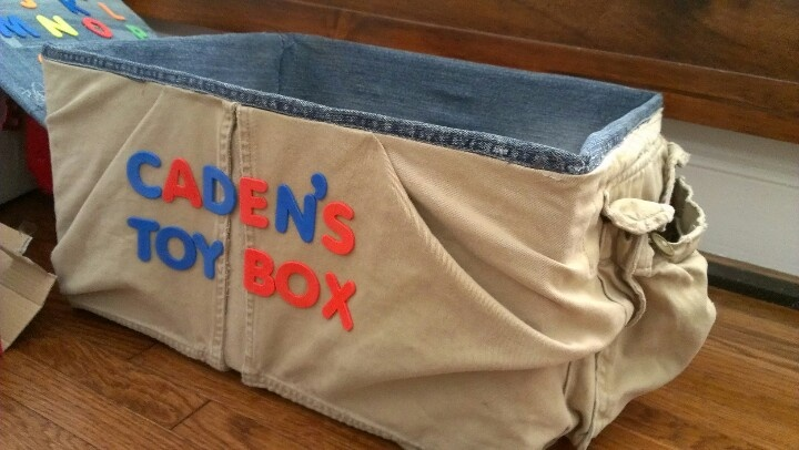 Child 39 s diy toy box cardboard box covered in old jeans for How to cover cardboard letters with fabric