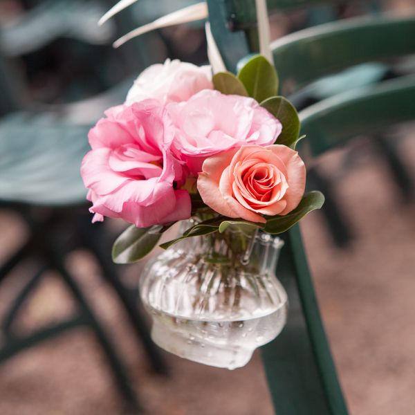 Little vintage vases and flowers lined the chairs in ceremony arbour. photo: www.eyecontact.ca