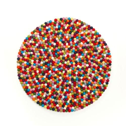 Fun, multi-colour felt rug, perfect for a touch of colour in your little ones room! Made in Nepal from hand sawn, individual balls making each rug is hard wearing and individual.